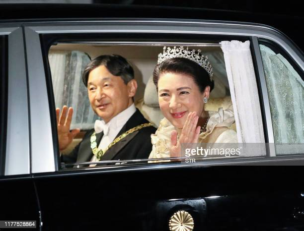 Japan's Emperor Naruhito and Empress Masako depart Akasaka Palace for the court banquet at the Imperial Palace in Tokyo on October 22, 2019. -...