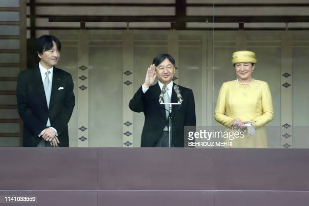 Japan's Emperor Naruhito and Empress Masako make their first public appearance after ascending to the throne along with Crown Prince Akishino at the...
