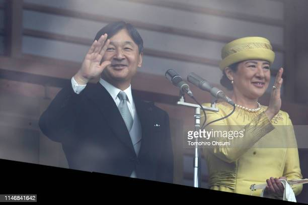 Japan's Emperor Naruhito and Empress Masako wave to members of the public from the balcony of the Imperial Palace on May 04 2019 in Tokyo Japan...