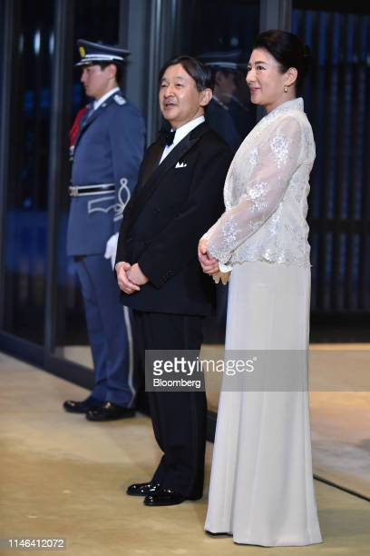 Japan's Emperor Naruhito center and Japan's Empress Masako right await the arrival of US President Donald Trump and First Lady Melania Trump not...