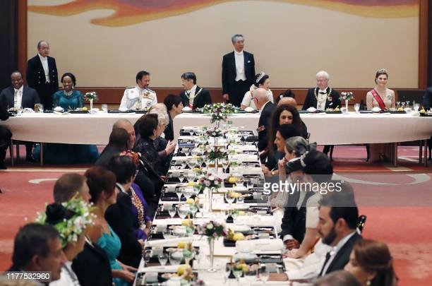 Japan's Emperor Naruhito Empress Masako foreign dignitaries and government representatives attend the court banquet at the Imperial Palace in Tokyo...
