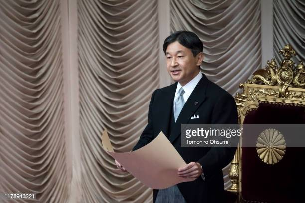 Japan's Emperor Naruhito gives an address during the opening of the 200th extraordinary diet session at the upper house of the parliament on October...