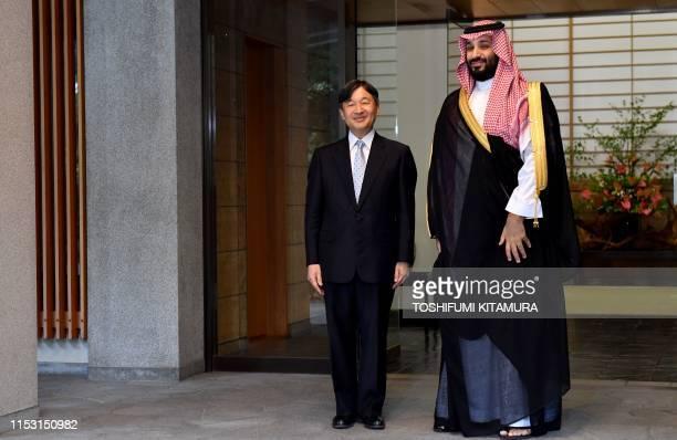 Japan's Emperor Naruhito greets Saudi Arabia's Crown Prince Mohammed bin Salman upon his arrival at the Akasaka Imperial Palace in Tokyo on July 2,...
