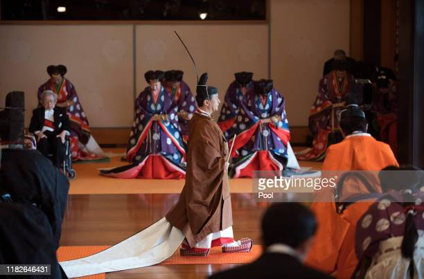 Japan's Emperor Naruhito leaves at the end of the enthronement ceremony where he officially proclaimed his ascension to the Chrysanthemum Throne at...