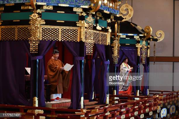 Japan's Emperor Naruhito left delivers a speech as Empress Masako looks on the enthronement ceremony at the Imperial Palace in Tokyo Japan on Tuesday...