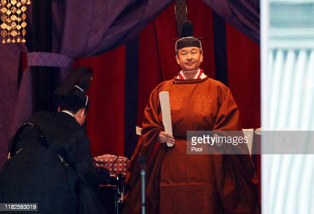Japan's Emperor Naruhito makes his appearance during a ceremony to proclaim his enthronement to the world called SokuireiSeidennogi at the Imperial...