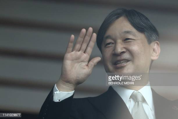 Japan's Emperor Naruhito waves as he makes his first public appearance after ascending to the throne at the Imperial Palace in Tokyo on May 4 2019