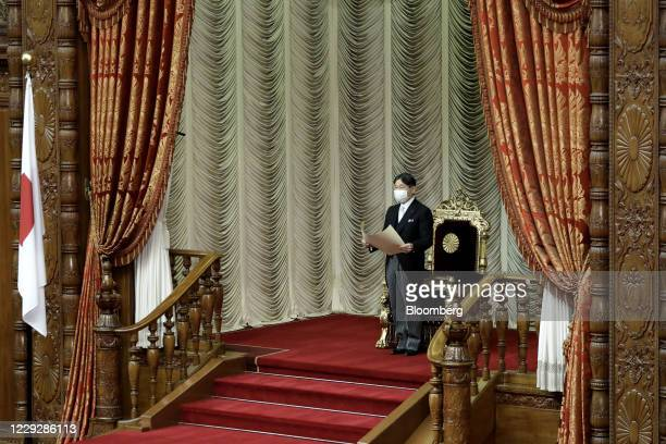 Japan's Emperor Naruhito wears a protective face mask as he declares the opening of an extraordinary session at the upper house of the parliament in...