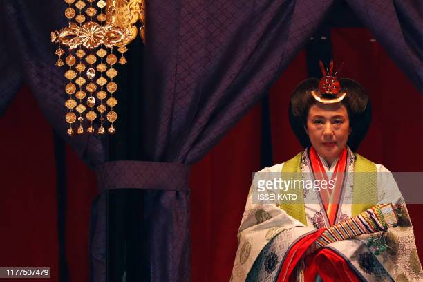 Japan's Empress Masako makes her appearance during a ceremony to proclaim Emperor Naruhito's enthronement to the Chrysanthemum Throne during an...