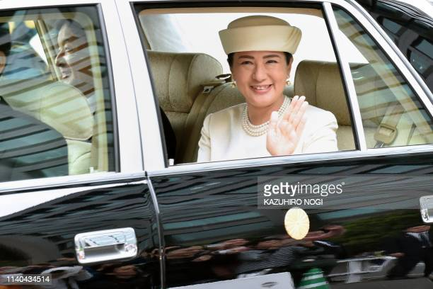 Japan's Empress Masako waves to wellwishers upon her arrival with new Emperor Naruhito back to the Imperial Palace in Tokyo on May 1 2019 Japan's new...