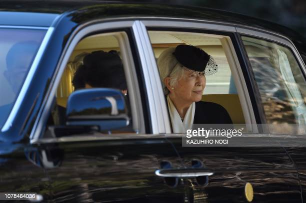 Japan's Empress Michiko looks at the tomb of late emperor Hirohito as she leaves after offering prayers at the Musashino Imperial Mausoleum in...