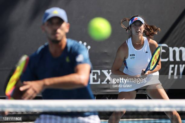 Japan's Ena Shibahara and her partner Ben McLachlan play their mixed doubles match against Germany's Kevin Krawietz and Laura Siegemund on day five...
