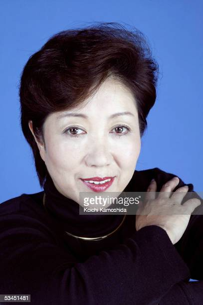 Japan's Environment Minister Yuriko Koike who will run in the next election as Liberal Democratic Party backed candidate poses at a Tokyo studio on...
