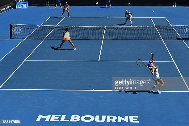 Japan's Eri Hozumi and Miyu Kato play a point during their women's doubles semifinal match against Bethanie MattekSands of the US and Czech...