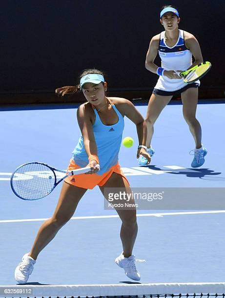 Japan's Eri Hozumi and Miyu Kato play against Croatia's Mirjana LucicBaroni and German Andrea Petkovic in the women's doubles quarterfinals of the...