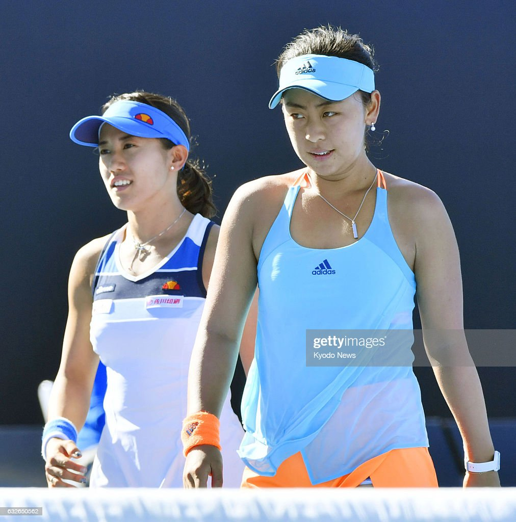 Japan's Eri Hozumi (R) and Miyu Kato react after losing to Bethanie Mattek-Sands of the United States and Czech Lucie Safarova in the Australian Open women's doubles semifinals in Melbourne on Jan. 25, 2017.