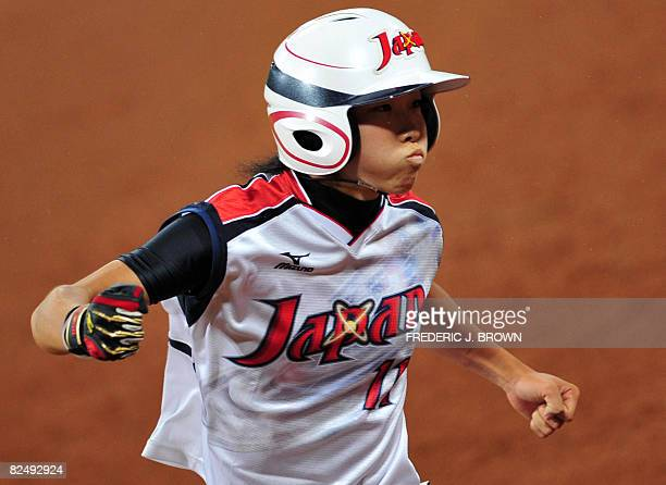 Japan's Eri Yamada celebrates after her fourth inning homerun off a hit off a pitch by Cat Osterman in their gold medal final at the Fengtai Softball...
