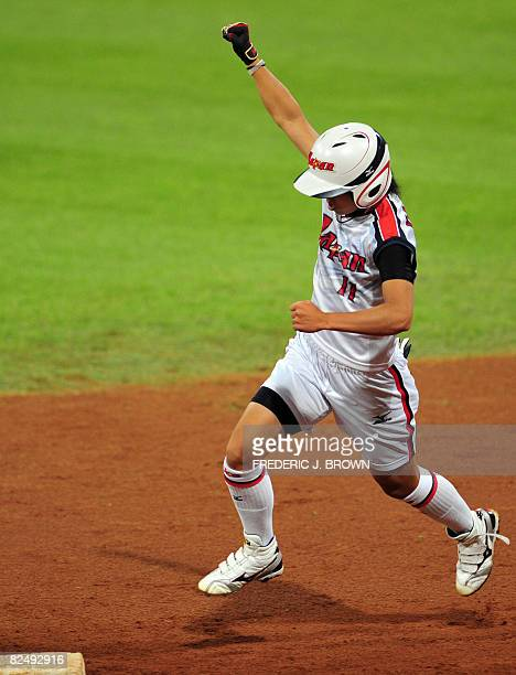 Japan's Eri Yamada gestures while crossing second base on her way home after her fouth inning homerun off a pitch by Cat Osterman of the US in their...