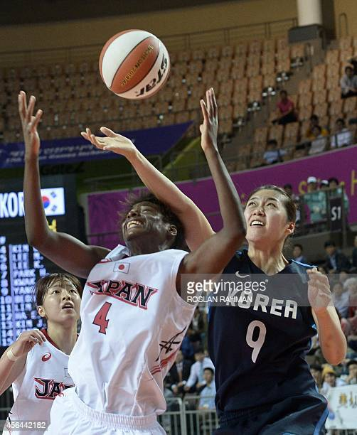 Japan's Evelyn Mawuli fights for the ball with South Korea's Yang Jihee in the women's basketball semifinals during the 2014 Asian Games at the...