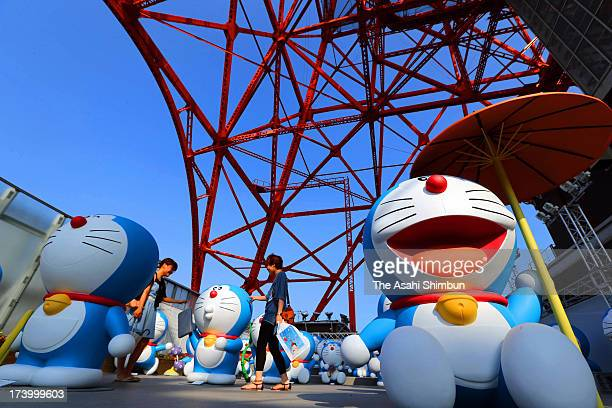 Japan's famous cartoon character Doraemon lifesize figures are arranged during the press preview of the cartoonist 'Fujiko F Fujio Exhibition' at...