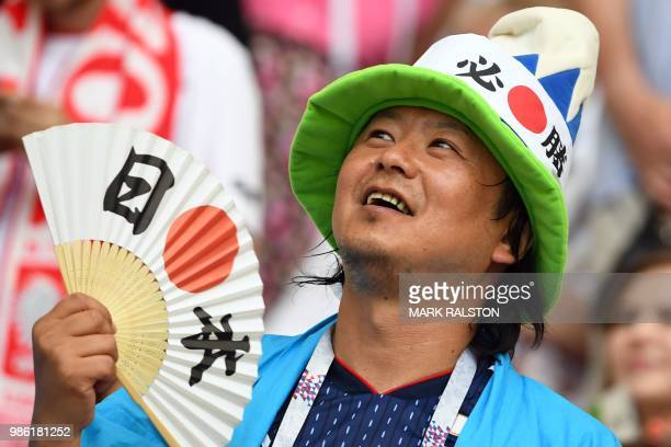 A Japan's fan gestures during the Russia 2018 World Cup Group H football match between Japan and Poland at the Volgograd Arena in Volgograd on June...