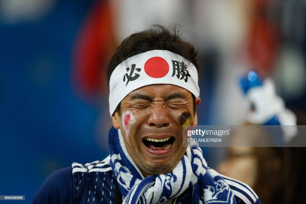 A Japan's fan reacts at the end of the Russia 2018 World Cup round of 16 football match between Belgium and Japan at the Rostov Arena in Rostov-On-Don on July 2, 2018. Belgium won 3-2. (Photo by Odd ANDERSEN / AFP) / RESTRICTED