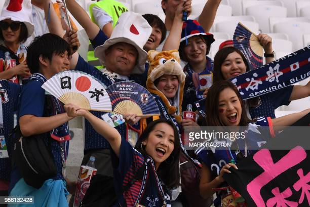 Japan's fans cheer their team before the Russia 2018 World Cup Group H football match between Japan and Poland at the Volgograd Arena in Volgograd on...