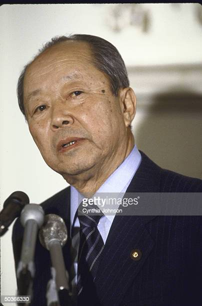 Japan's Finance Minister Kiichi Miyazawa holding a press conference after meeting with US Treasury Secy James A Baker III