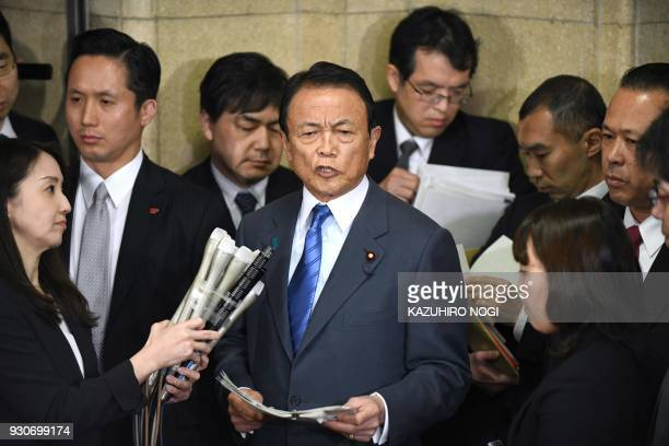 TOPSHOT Japan's Finance Minister Taro Aso answers questions during a press briefing at the finance ministry in Tokyo on March 12 2018 Japan's finance...