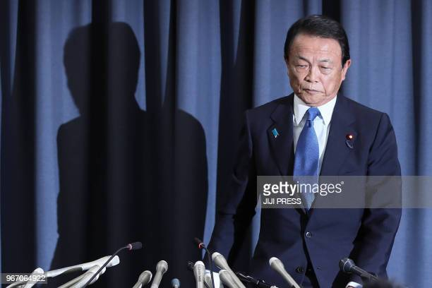 Japan's Finance Minister Taro Aso attends a press conference in Tokyo on June 4 2018 Japan's Finance Minister Taro Aso said on June 4 he was...