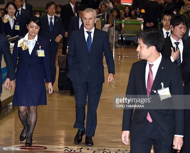 Japan's football coach Javier Aguirre of Mexico is escorted by airport employees upon his arrival at Narita Airport suburban Tokyo after being...