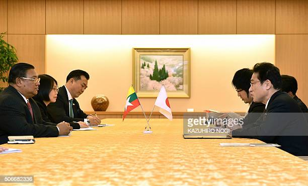 Japan's Foreign Minister Fumio Kishida speaks with Myanmar's Foreign Minister Wunna Maung Lwin during their meeting at the Foreign Ministry in Tokyo...