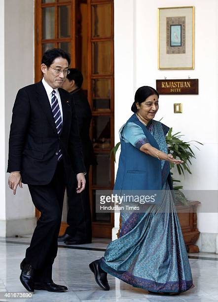 Japan's Foreign Minister Fumio Kishida with Indian External Affairs Minister Sushma Swaraj before their meeting on January 17 2015 in New Delhi India...