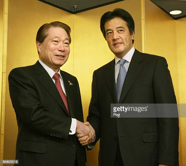 Japan's Foreign Minister Katsuya Okada shakes hands with his South Korean counterpart Yu Myunghwan during a twoday meeting by East Asian and Latin...