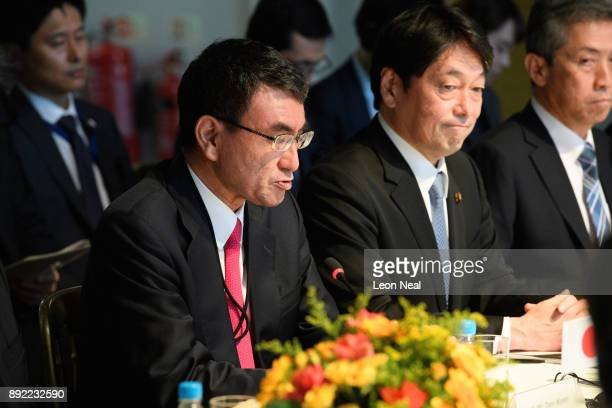 Japan's Foreign Minister Taro Kono and Japanese Defence Minister Itsunori Onodera speak at the head of a meeting on December 14 2017 in London...