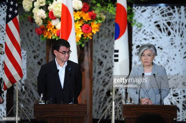Japan's Foreign Minister Taro Kono and South Korea's Foreign Minister Kang Kyungwha attend a press conference with US Secretary of State Mike Pompeo...