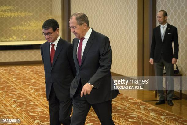 Japan's Foreign Minister Taro Kono walks with his Russian counterpart Sergei Lavrov before their meeting in Tokyo on March 21 2018 / AFP PHOTO / POOL...