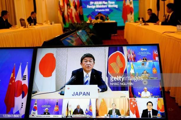 Japan's Foreign Minister Toshimitsu Motegi addresses counterparts from ASEAN, China and South Korea through a live video conference during the 21st...