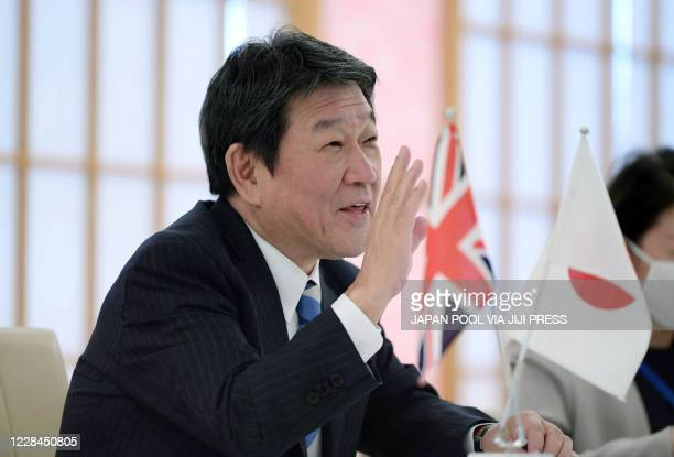 Japan's Foreign Minister Toshimitsu Motegi attends a television talk with British International Trade Secretary Liz Truss at the foreign minsitry in...
