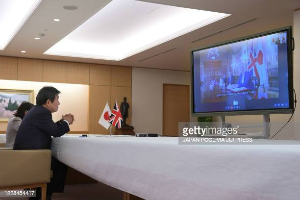 Japan's Foreign Minister Toshimitsu Motegi holds a television talk with British International Trade Secretary Liz Truss at the foreign ministry in...
