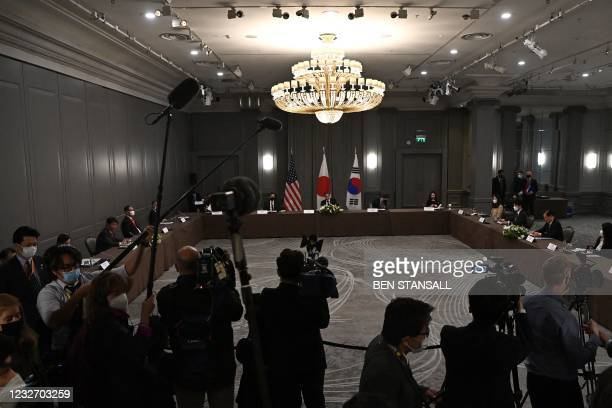 Japan's Foreign Minister Toshimitsu Motegi, US Secretary of State Antony Blinken and South Korea's foreign minister Chung Eui-yong take part in a...