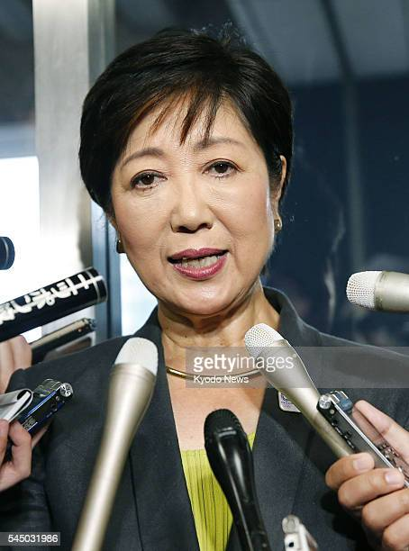 Japan's former Defense Minister Yuriko Koike who is planning to run in the July 31 Tokyo gubernatorial election meets with reporters after holding...
