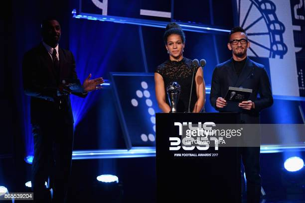 Japan's former player Hidetoshi Nakata and Germany's Celia Sasic come on stage to present The Best FIFA Women's Player during The Best FIFA Football...