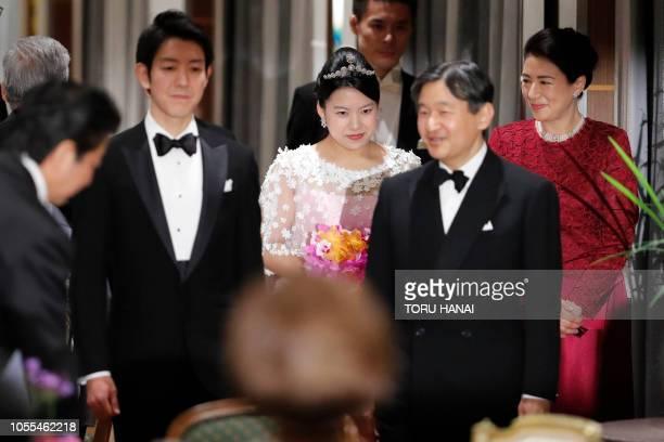TOPSHOT Japan's former princess Ayako Moriya and her husband Kei Moriya arrive at their wedding banquet with Crown Prince Naruhito and Crown Princess...