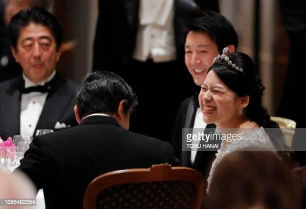 Japan's former princess Ayako Moriya and her husband Kei Moriya talk with Crown Prince Naruhito as Prime Minister Shinzo Abe looks on at their...