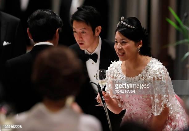 Japan's former princess Ayako Moriya and her husband Kei Moriya toast with Crown Prince Naruhito at their wedding banquet in Tokyo on October 30 2018