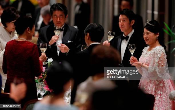 Japan's former princess Ayako Moriya and her husband Kei Moriya toast with Crown Prince Naruhito Crown Princess Masako Prime Minister Shinzo Abe and...