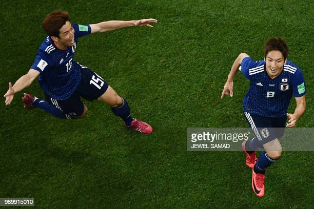Japan's forward Genki Haraguchi celebrates with Japan's forward Yuya Osako after scoring a goal during the Russia 2018 World Cup round of 16 football...