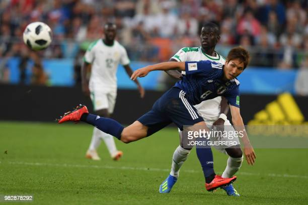 Japan's forward Genki Haraguchi kicks the ball in front of Senegal's midfielder Papa Alioune Ndiaye during the Russia 2018 World Cup Group H football...