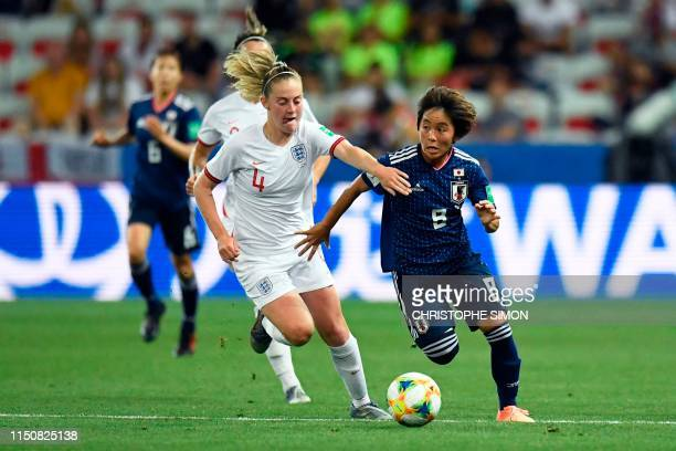 Japan's forward Mana Iwabuchi vies for the ball with England's midfielder Keira Walsh during the France 2019 Women's World Cup Group D football match...